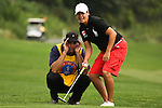 Angela Buzminski from Oshawa, Ontario and her caddie screen the green on the18th hole at Alliance Bank Golf Classic in Syrcause, NY..