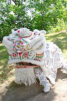 Colorful Asian dragon ready to dance in festival ceremony. Dragon Festival Lake Phalen Park St Paul Minnesota USA