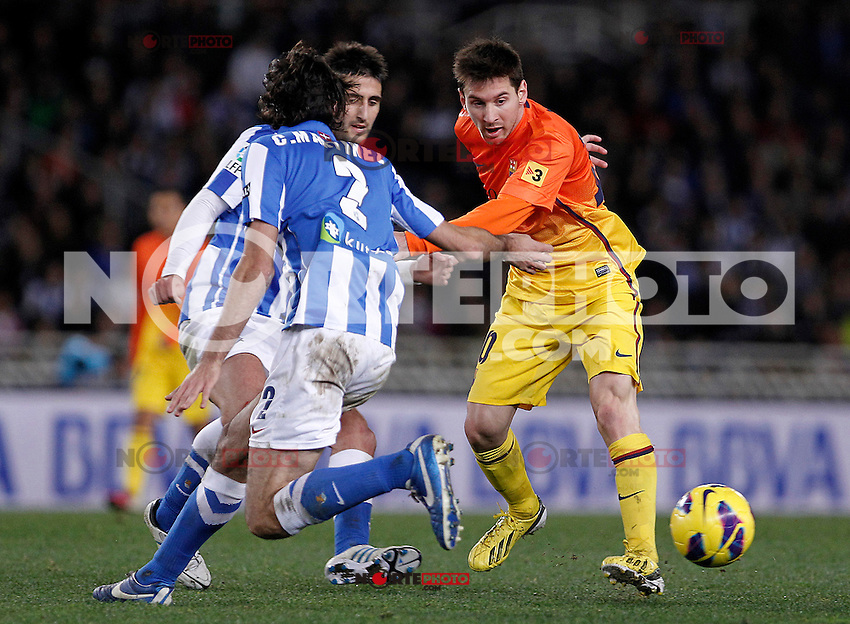 Real Sociedad's Markel Bergara (l) and Carlos Martinez Diez (c) and FC Barcelona's Leo Messi (r) during La Liga match.January 19,2013. (ALTERPHOTOS/Acero) /NortePhoto