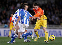 Real Sociedad's Markel Bergara (l) and Carlos Martinez Diez (c) and FC Barcelona's Leo Messi (r) during La Liga match.January 19,2013. (ALTERPHOTOS/Acero) /NortePhoto