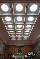 Eighteen circular skylights, each one framed in a stucco boarder, light the music room