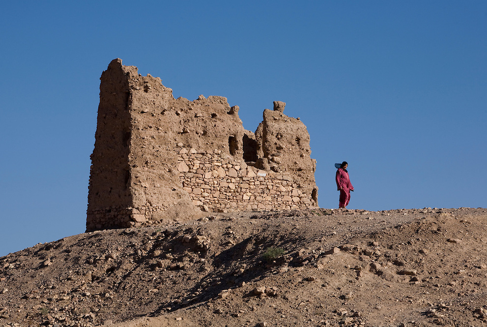 A visitor walks atop the ruins of the village and kasbah of Ait Benhaddou in Southern Morocco.