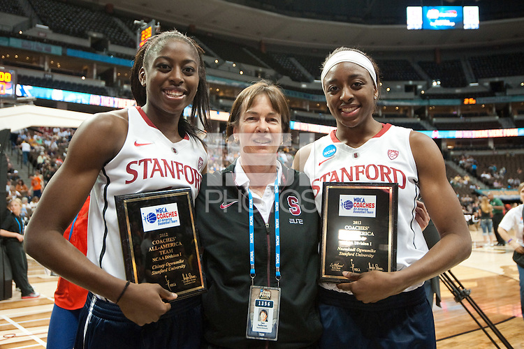 DENVER, CO--Chiney Ogwumike and Nneka Ogwumike stand with Head Coach Tara VanDerveer aftre receiving their awards during the WBCA All American awards at the Pepsi Center for the 2012 NCAA Women's Final Four festivities in Denver, CO.