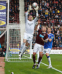 Allan McGregor clutches the ball which may have gone over