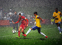 Sebia's Milan Gajic passes in the rain during the FIFA Under-20 Football World Cup Final between Brazil (gold) and Serbia at North Harbour Stadium, Albany, New Zealand on Saturday, 20 June 2015. Photo: Dave Lintott / lintottphoto.co.nz