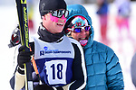 FRANCONIA, NH - MARCH 11:   Jackson Hill of the University of Colorado stands with a family member after the Men's 20K Freestyle event at the Division I Men's and Women's Skiing Championships held at Jackson Ski Touring on March 11, 2017 in Jackson, New Hampshire. (Photo by Gil Talbot/NCAA Photos via Getty Images)