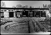 RGS roundhouse and turntable at Ridgway.  Inside are #20, #25, #40, #22 and #42, almost a full house.<br /> RGS  Ridgway, CO  Taken by Jackson, Richard B. - 8/8/1937