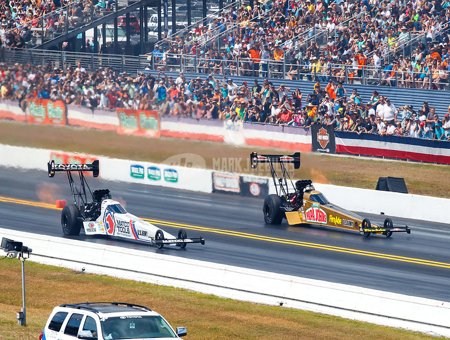 Mar 18, 2018; Gainesville, FL, USA; NHRA top fuel driver Antron Brown (left) races alongside Leah Pritchett during the Gatornationals at Gainesville Raceway. Mandatory Credit: Mark J. Rebilas-USA TODAY Sports