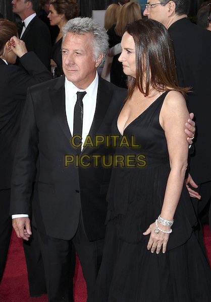 Dustin Hoffman & Lisa Gottsegen.85th Annual Academy Awards held at the Dolby Theatre at Hollywood & Highland Center, Hollywood, California, USA..February 24th, 2013.oscars half length dress profile married husband wife black white tie suit shirt .CAP/ADM/SLP/COL.©Colin/StarlitePics/AdMedia/Capital Pictures