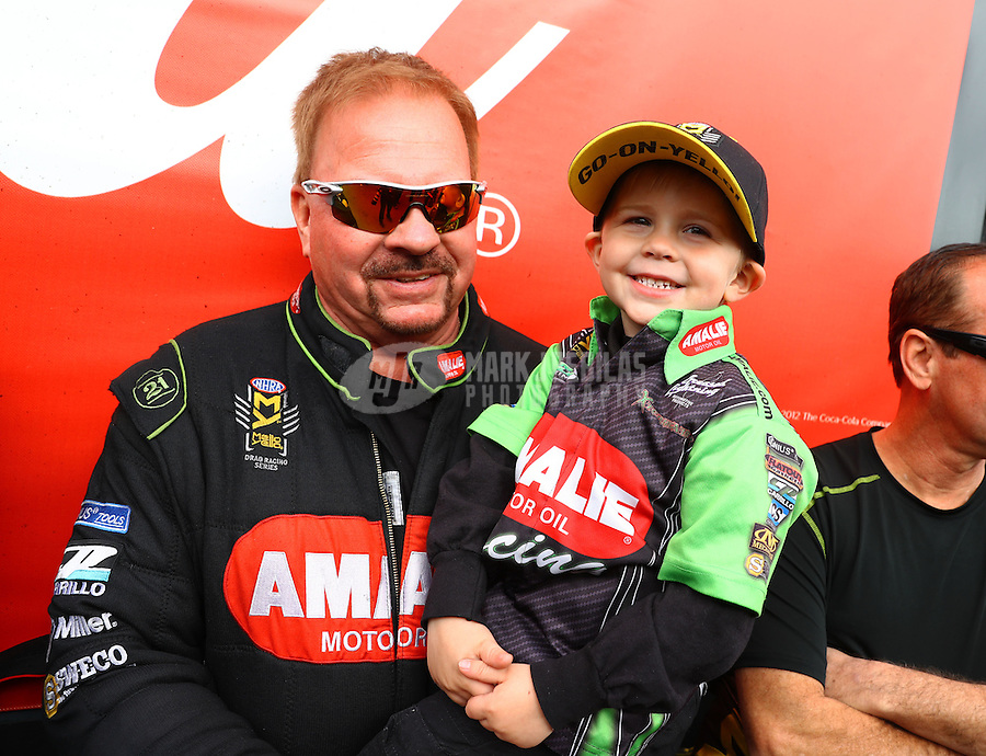 Feb 26, 2017; Chandler, AZ, USA; NHRA top fuel driver Terry McMillen with son Cameron McMillen during the Arizona Nationals at Wild Horse Pass Motorsports Park. Mandatory Credit: Mark J. Rebilas-USA TODAY Sports