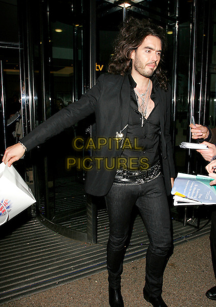RUSSELL BRAND.British Comedy Awards 2006, London Television Studios, London, UK. - Departures.December 13th, 2006.full length black top belt jeans denim goody bag unbuttoned.CAP/AH.©Adam Houghton/Capital Pictures
