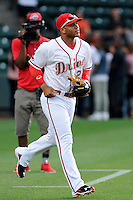 Second baseman Yoan Moncada (24) of the Greenville Drive runs out to his position for the first time before a game against the Lexington Legends on Monday, May 18, 2015, at Fluor Field at the West End in Greenville, South Carolina. Moncada, a 19-year-old prospect from Cuba, made his professional debut tonight in the Red Sox organization. (Tom Priddy/Four Seam Images)