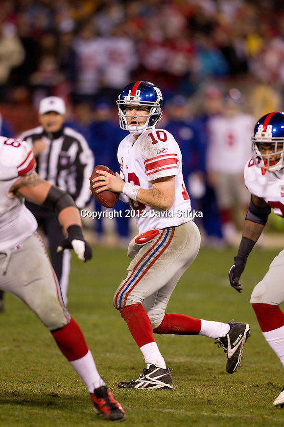 New York Giants quarterback Eli Manning (10) drops back to pass during an NFC Championship NFL football game against the San Francisco 49ers on January 22, 2012 in San Francisco, California. The Giants won 20-17 in overtime. (AP Photo/David Stluka)