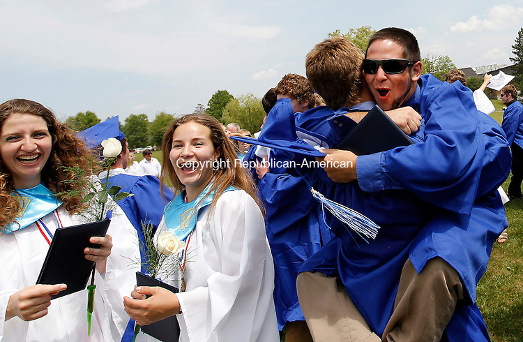 Washington, CT-26, June 2010-062610CM09 Shepaug Valley High School graduate, Tyler Stinson, jumps into the arms of Kevin Wolfe after graduating Saturday afternoon in Washington.  --Christopher Massa Republican-American