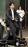 """September 29, 2017, Tokyo, Japan - Former Formula 1 driver Ukyo Katayama drives an eleectric personal mobility """"Landboard"""" developed by Japanese automobile venture Exmachina at a press preview in Tokyo on Friday, September 29, 2017. Exmachina also displayed two-seater electric vehicle Earth-1 which enables to transform its body like a robot.   (Photo by Yoshio Tsunoda/AFLO) LWX -ytd-"""