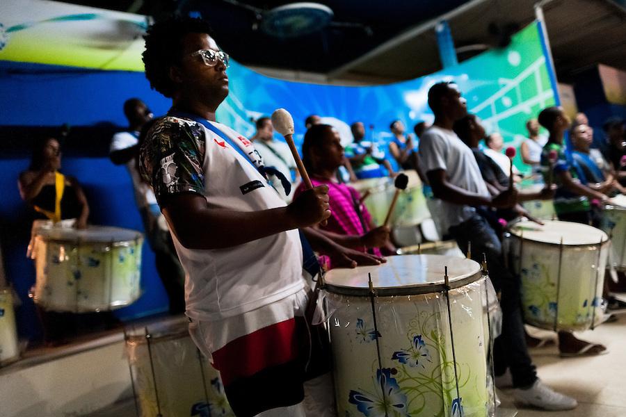 Rocinha samba school drummers (bateria) rehearse their Carnival music song at the school's quadra (samba court) in Rocinha, Rio de Janeiro, Brazil, 17 February 2012.