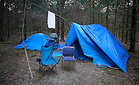 NWA Democrat-Gazette/DAVID GOTTSCHALK - 1/30/15 - A campsite in the woods south of Martin Luther King Jr. Boulevard in Fayetteville Friday January 30, 2015 in the predawn hours. Areas with a homeless population were visited during the  Northwest Arkansas' biennial, 24-hour homeless census.