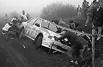 Pix: Shaun Flannery/shaunflanneryphotography.com...COPYRIGHT PICTURE>>SHAUN FLANNERY>01302-570814>>07778315553>>..1990 Lombard RAC Rally..Marshals and spectators attempt to remove the Mitsubishi Galant VR-4 of Soren Nilsson and Per-Ove Persson (Mitsubishi Ralliart Sweden) from a ditch.