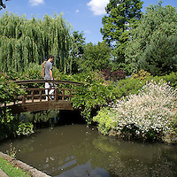 Regent's Park is one of the Royal Parks of London partly in the City of Westminster and partly in the London Borough of Camden. The 166 hectare park including gardens, a lake with a heronry, waterfowl and a boating area, sports pitches, and children's playgrounds; the London Zoo and the headquarters of the Zoological Society of London. A wooden bridge in Regent's Park.