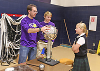 Guerin Catholic students set up a science expo for the students at Our Lady of Mt. Carmel. The students were able to move from demonstration to demonstration and see science in action.  JP Spoonmore (left) and Dominic Stein show what static electricity does to 5th grader Sarah Schramm.