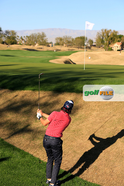 Ryo Ishikawa (JPN) chips onto the 16th green during Saturday's Round 3 of the 2017 CareerBuilder Challenge held at PGA West, La Quinta, Palm Springs, California, USA.<br /> 21st January 2017.<br /> Picture: Eoin Clarke | Golffile<br /> <br /> <br /> All photos usage must carry mandatory copyright credit (&copy; Golffile | Eoin Clarke)