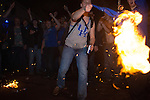 A Kentucky fan whips some burning clothing after UConn defeated Kentucky in Lexington, Ky., on Monday, April 7, 2014. Photo by Adam Pennavaria | Staff