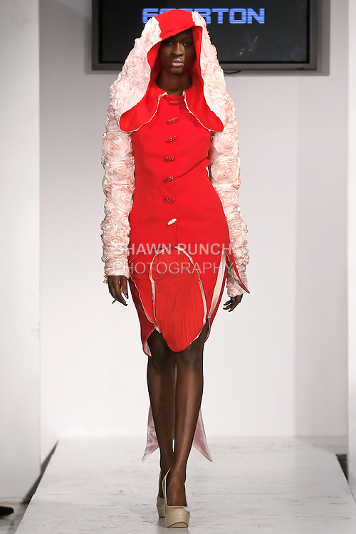 """Model walks runway in an outfit from the Berchell Egerton Fall Winter 2012 """"Chival Die Damsel"""" collection, by Berchell Egerton, during BK Fashion Weekend Fall Winter 2012."""