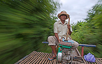 Locals and now also Tourist traveling on the unique Bamboo Train in the Battambang Rural country side, Cambodia.