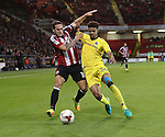 Billy Sharp of Sheffield United tussles with Jake Clarke-Salter of Bristol Rovers during the EFL League One match at the Bramall Lane Stadium, Sheffield. Picture date: September 27th, 2016. Pic Jamie Tyerman/Sportimage
