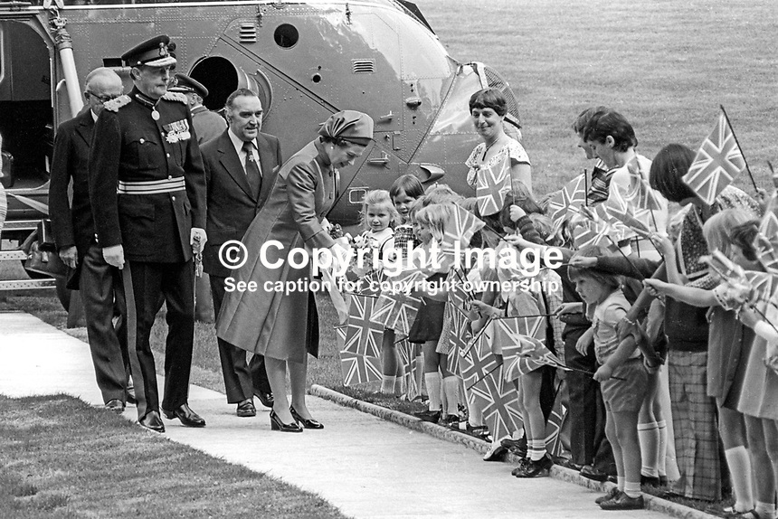 At the start of her Silver Jubilee Visit to N Ireland Queen Elizabeth II is greeted by local school children after her arrival by helicopter at Hillsborough Castle, her official residence whilst visiting the Province. Immediately behind her is Roy Mason, Secretary of State for N Ireland. 197708100074P<br />