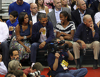 Washington, D.C- July 16 2012: President Barack Obama sipping on a beer with daughter Sasha and Michelle Obama and Joe Biden and with his daughter at the USA Basketball game at Verizon Center in Washington, D.C. © mpi34/MediaPunch Inc.