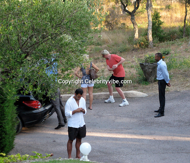 **EXCLUSIVE**.Boris Becker showing his Tennis moves to a girl..Amir Annual Summer Party.Private Villa..St Tropez, France..Wednesday, July 29, 2009..Photo By Celebrityvibe.com.To license this image please call (212) 410 5354; or Email: celebrityvibe@gmail.com ; .website: www.celebrityvibe.com.
