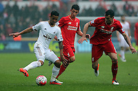 (L-R) Kyle Naughton of Swansea City marked by Cameron Brannagan and Dejan Lovren of Liverpool during the Barclays Premier League match between Swansea City and Liverpool at the Liberty Stadium, Swansea on Sunday May 1st 2016