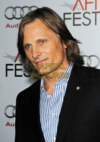"VIGGO MORTENSEN .arriving at AFI Fest's Gala Screening of ""The Road"" at Grauman's Chinese Theatre in Hollywood, California.  November 4th 2009..portrait headshot blue striped shirt black pin badge brooch  .CAP/ROT.©Lee Roth/Capital Pictures"
