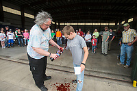 NWA Democrat-Gazette/BEN GOFF @NWABENGOFF<br /> Evelyn Allen applies fake blood to 'victims' Friday, March, 23, 2018, during disaster training at Northwest Arkansas Regional Airport in Highfill. Multiple Northwest Arkansas emergency agencies participated in the training, with volunteers acting as victims to create a simulated aircraft emergency. The airport holds the large-scale, multi-agency drills every three years according to Gilbert Neil, the airport's public safety director.