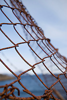 Closeup of rusty chainlink fence