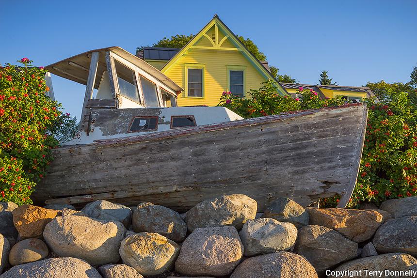 Stonington, Maine:<br /> Relic wooden lobster boat as wharf onrament, Stonington Harbor