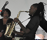 Lakecia Benjamin, playing Saxophone, with the Charenee Wade Group that started the music at the Annual Jazz in the Valley Festival,  in Waryas Park in Poughkeepsie, NY, on Sunday, August 21, 2016. Photo by Jim Peppler. Copyright Jim Peppler 2016 all rights reserved.