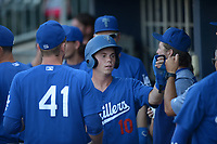 NWA Democrat-Gazette/ANDY SHUPE<br /> Tulsa Drillers third baseman Will Smith is congratulated in the dugout Wednesday, July 11, 2018, after hitting a two-run double and later scoring during the first inning against the Northwest Arkansas Naturals at Arvest Ballpark in Springdale. Visit nwadg.com/photos to see more photographs from the game.