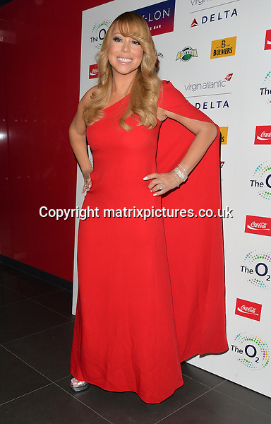 NON EXCLUSIVE PICTURE: MATRIXPICTURES.CO.UK<br /> PLEASE CREDIT ALL USES<br /> <br /> WORLD RIGHTS <br /> <br /> American pop singer Mariah Carey attending her after-show party, held at London's Nylon Club.<br /> <br /> The Grammy award-winning star wears single-sleeved red caped gown paired with silver peep-toe platforms.<br /> <br /> MARCH 23rd 2016<br /> <br /> REF: LTN 16792