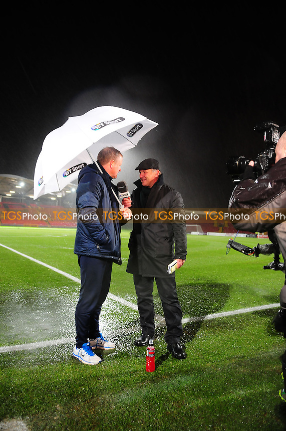 Oxford United manager Chris Wilderchats to BT Sport Presenters after the game is called off - Gateshead vs Oxford United - FA Cup 1st Round Replay at the Gateshead International Stadium - 20/11/13 - MANDATORY CREDIT: Steven White/TGSPHOTO - Self billing applies where appropriate - 0845 094 6026 - contact@tgsphoto.co.uk - NO UNPAID USE