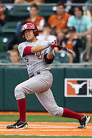 Oklahoma Sooners second baseman Hector Lorenzana #12 follows through on his swing against the Texas Longhorns in the NCAA baseball game on April 5, 2013 at UFCU DischFalk Field in Austin Texas. Oklahoma defeated Texas 2-1. (Andrew Woolley/Four Seam Images).