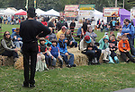 Patrick Wadden, of the Arm-of-the-Sea Theater, greeting the audience before a performance on the Bandstand Stage at the 27th Annual Hudson Valley Garlic Festival, held in Cantine Memorial Field, in Saugerties, NY, on Saturday, October 1, 2016. Photo by Jim Peppler; Copyright Jim Peppler 2016.