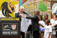 U.S. Soccer President and USA Bid Committee Chairman Sunil Gulati (R) presents former President Bill Clinton (L)with a US Soccer jersey during press conference announcing former President Bill Clinton as the honorary chairman of the USA Bid Committee to host the FIFIA World Cup in 2018 or 2022 at the FC Harlem Field in Harlem, NY, on May 17, 2010.