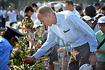 Jonathan Frerichs, a consultant to the World Council of Churches, deposits flowers on August 6, 2015, at a memorial in Hiroshima, Japan, that commemorates the victims of the atomic bombing of the city by the United States in 1945. A delegation of pilgrims from the World Council of Churches is in Hiroshima for the commemoration, and they will return home to build a movement to rid the world of nuclear weapons.