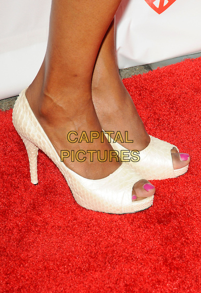 "AISHA TYLER's shoes .arriving at Children Mending Hearts' 3rd Annual ""Peace Please"" Gala at the Music Box @ Fonda in Hollywood, California, USA, April 16th, 2010.  .arrivals detail feet snake snakeskin platform peep toe white cream .CAP/ROT.©Lee Roth/Capital Pictures"