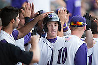 Toby Thomas (4) of the Winston-Salem Dash is congratulated by his teammates after hitting a home run against the Potomac Nationals at BB&T Ballpark on July 15, 2016 in Winston-Salem, North Carolina.  The Dash defeated the Nationals 10-4.  (Brian Westerholt/Four Seam Images)