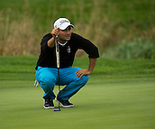 15.10.2014. The London Golf Club, Ash, England. The Volvo World Match Play Golf Championship.  Day 1 group stage matches.  Alexander Levy [FRA] lines up his putt on the fifteenth  green during his match against