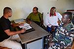 MADAGASCAR, Mananjary,  / MADAGASKAR, Mananjary, Fr. BENOIT URAN WUWUR SVD<br /> Steyler-Misisonar und Leiter der Kommission &quot;Justice et Paix&quot; (Justice and Peace) in der Di&ouml;zese Mananjary, auf Polizeistation im Gespr&auml;ch mit BRIGADEKOMMANDANT LENTIER<br /> leitet die Gendarmerie Nationale in Mananjary