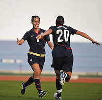US players Lauren Cheney #11 and Abby Wambach #20 run towards each other in celebration of Cheney's game winning goal vs Iceland in a 2010 Algarve Cup game in Vila Real Sto. Antonio, Portugal.